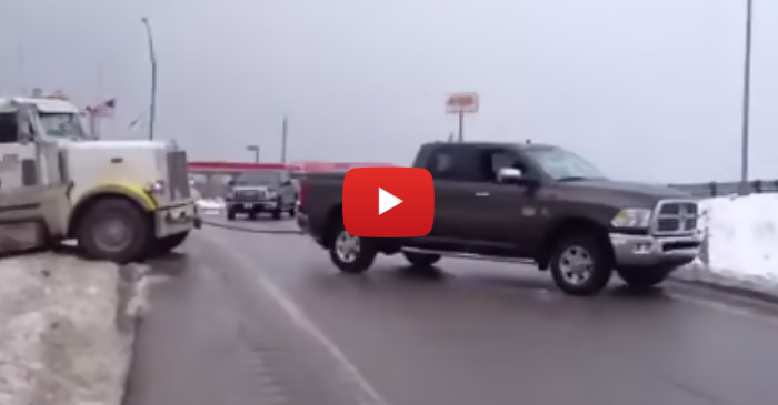 Dodge Ram Pickup Pulls a Semi Out of the Snow
