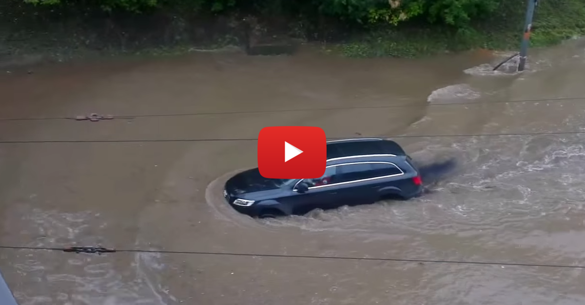 Why Would This Person Drive Their Audi Q7 Into a Flooded River?!