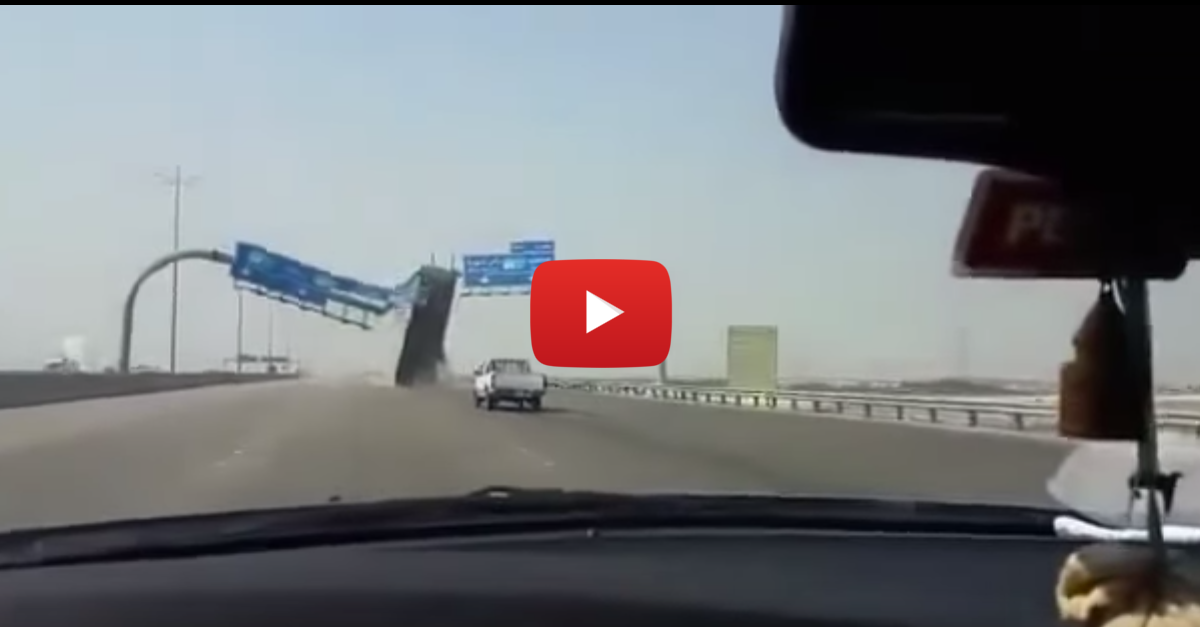 Truck Annihilates Highway Sign