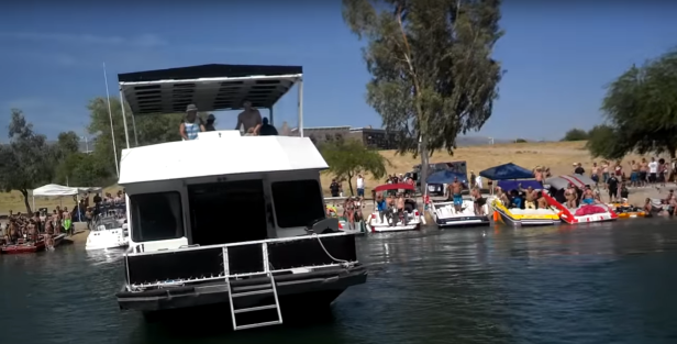 Drunk Idiot Yells at Another Drunk Idiot Driving a House Boat Into People