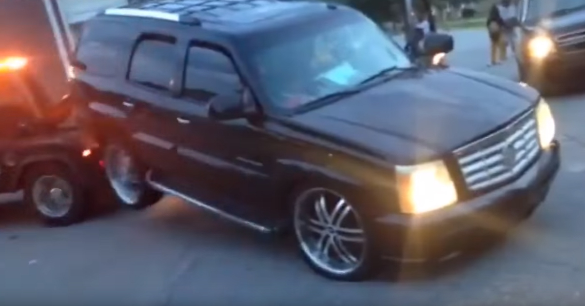 Neighbor Films a Woman Trying to Drive Off When The Repo Man Comes For Her Escalade