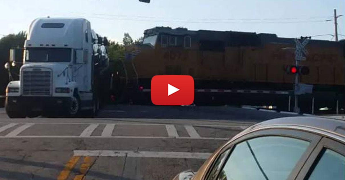 Big Rig Gets Stuck On Train Tracks