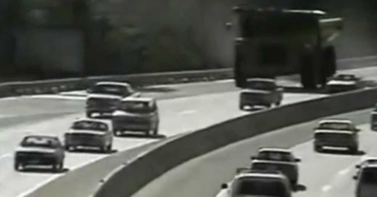 [VIDEO] Police Chase a Massive 100,000 Pound Dump Truck Down the Highway