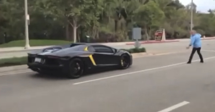 [VIDEO] Guy Throws a Rock at a Lamborghini Aventador So It'll Stop Racing
