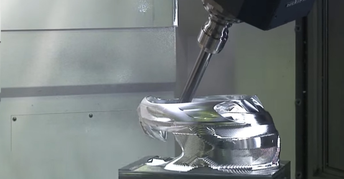 Watch a CNC machine turn a solid block of Aluminum into a full size motocross helmet