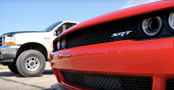 A coal rolling F-250 takes on a Challenger Hellcat