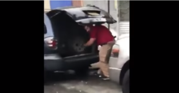 A man came out to his car and found a stranger going through his stuff