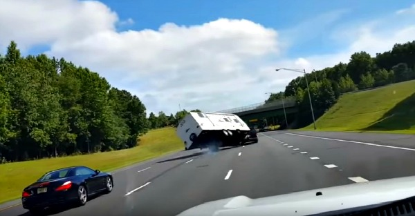 Dashcam captures the frightening moment a camper loses control on a busy highway