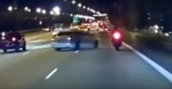 A car and a motorcycle try to out-stupid each other in a crazy road rage incident