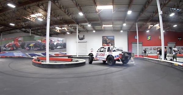 An offroad race truck on a go kart track looks like an obscene amount of fun