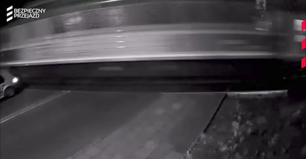 An oblivious driver goes straight through the train crossing