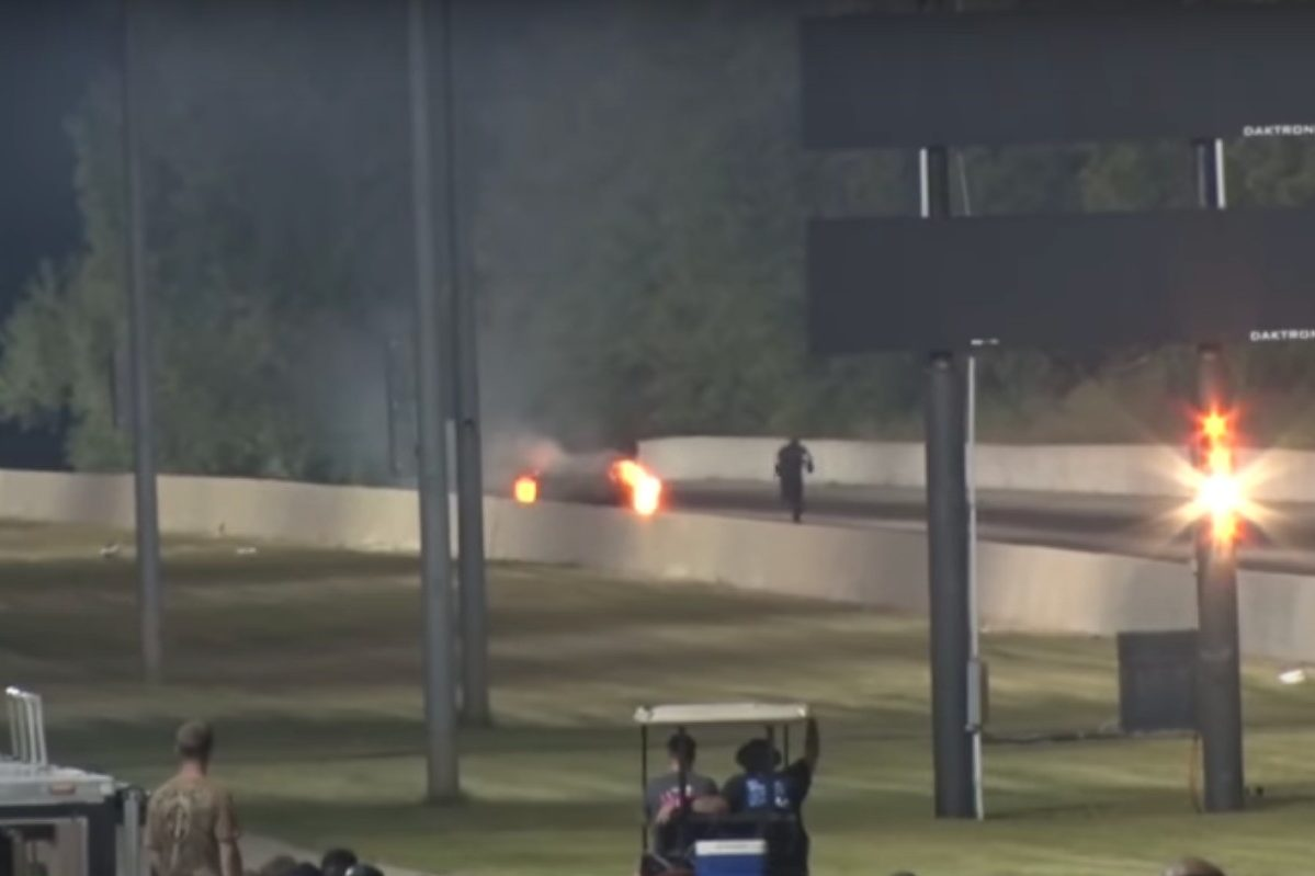 Drag Racer Jumps Out of Flaming Mustang