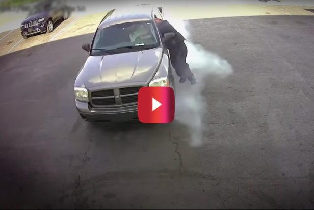 Gutsy Mechanic Dives Through Car Window to Stop Thief From Getting Away