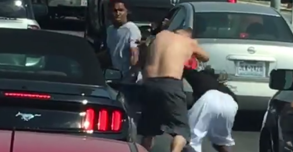 Shirtless guy brawls with two dudes in road rage at a stoplight
