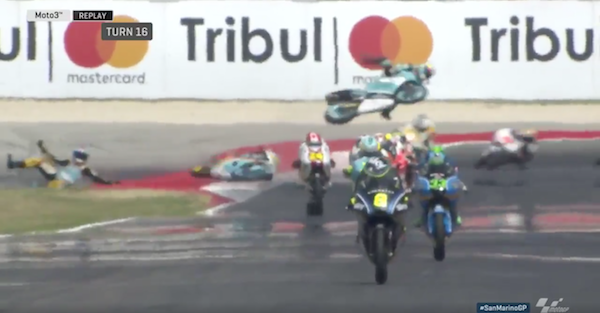 A motorcycle flies through the air during Moto3 qualifying