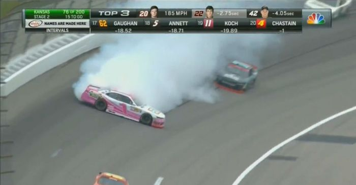 The first spin out at Kansas brings out the caution as smoke engulfs a car