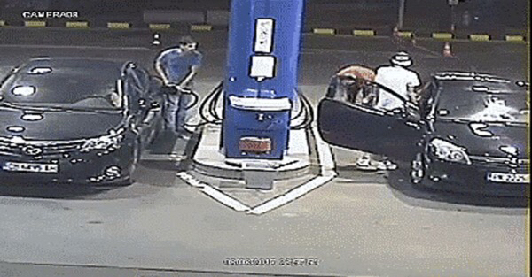 A gas station clerk uses a fire extinguisher to stop an unruly customer
