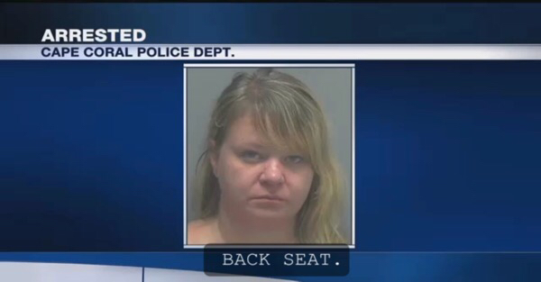 Cops find a woman passed out in her car with booze and pills. And that wasn't the only thing.