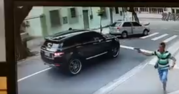 Video captures the scary moment a former world champ is carjacked at gunpoint