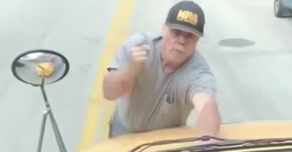 An irate man jumps on the hood of a school bus, and it goes downhill from there