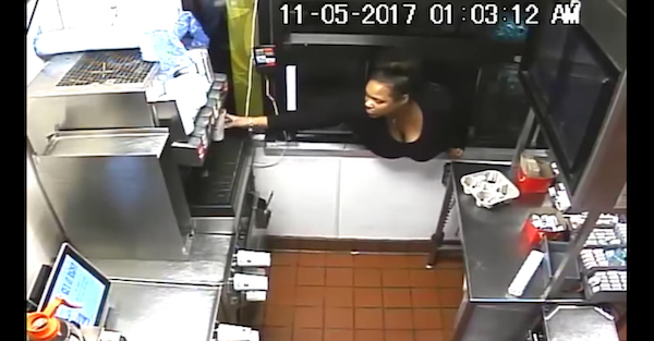 Woman caught on camera during an odd burglary of a drive through