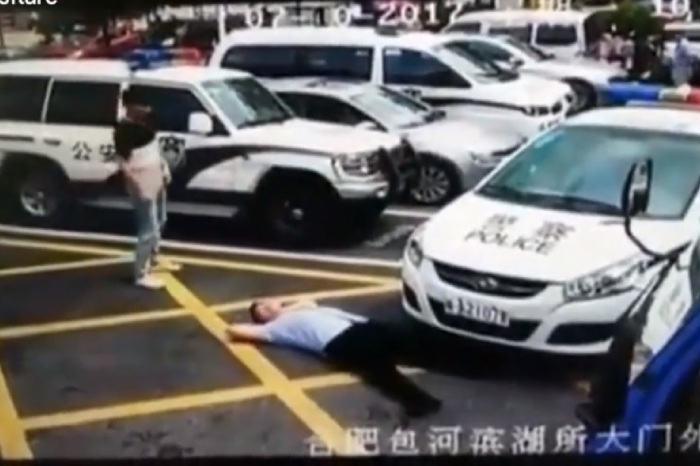This has to be worst acting job ever as guy pretends to get hit by cop car