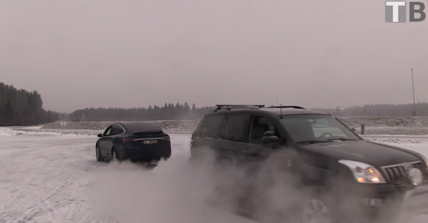 A Tesla and a Toyota Land Cruiser play tug of war and of course something breaks
