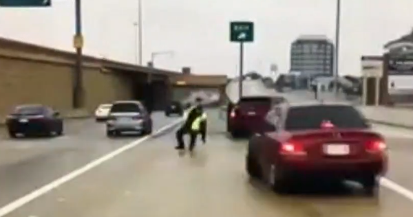 Cop was helping a motorist when a car hit a patch of ice. What happened next scared the hell out of him.