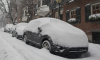 Snow covered car Scott Eisen Stringer