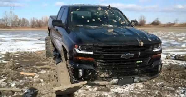 Guy tried to off road his new pickup over a frozen pond, and now faces all kinds of heartache