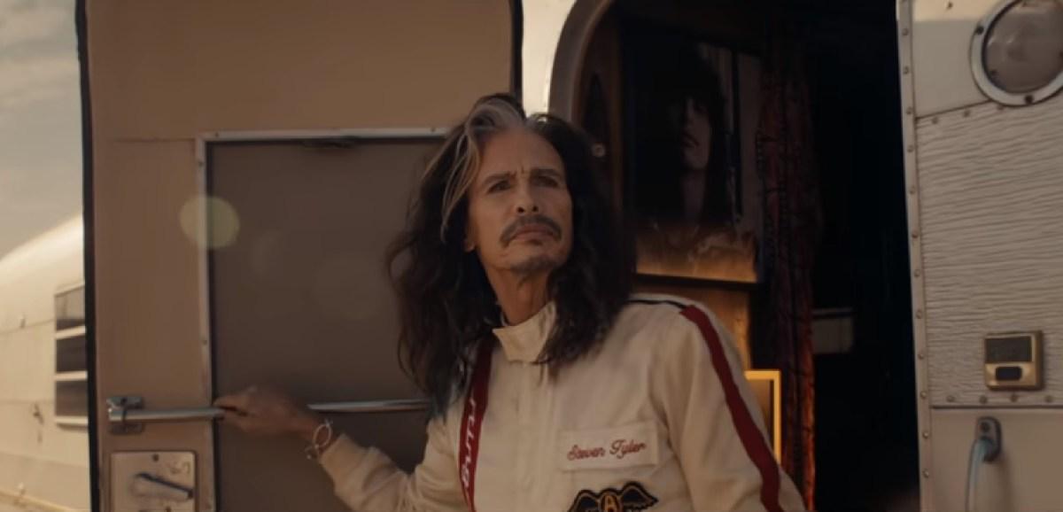 A music legend turns racecar driver in a much-anticipated Super Bowl ad