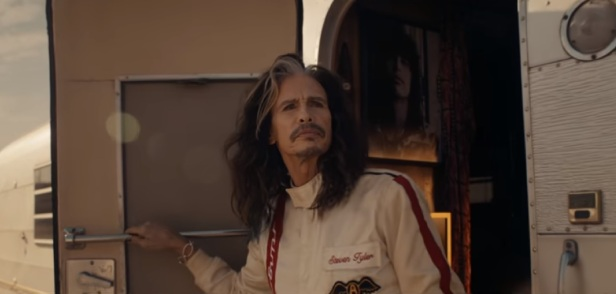 A music legend turns racecar driver in a much-anticipated Super Bowl ad