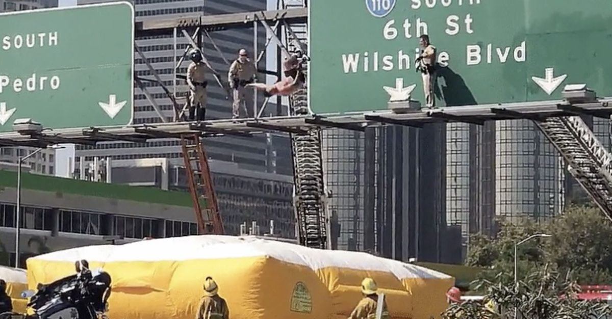 Pollution Protester Ends Traffic-Causing Tomfoolery with Crazy Stunt