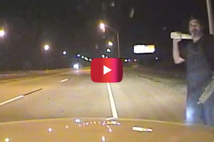 Dashcam Video Shows Escaped Hospital Patient Smashing Police Car Window in Tulsa
