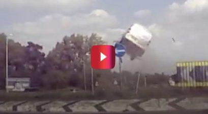van flies over roundabout