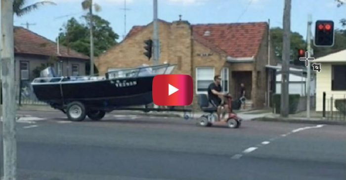Man Picks a Wild Way to Tow His Fishing Boat