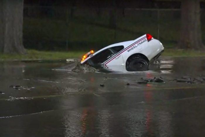 Car Gets Swallowed by a Sinkhole After Water Main Break