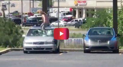 woman smashing car windshield