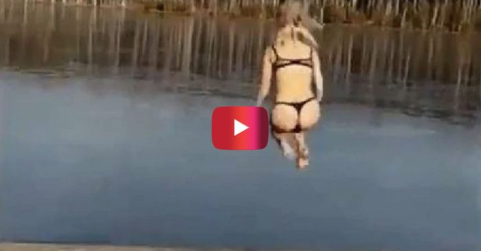 Russian Girl Tries Cannonballing into Lake, Ends up Regretting it Big Time