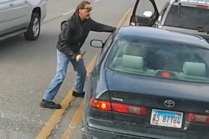 Angry Man Bashes Driver's Door With Knife in Wild Road Rage Video