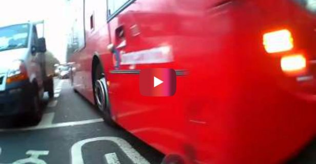 Bus Driver Runs a Red Light and Comes INCHES Away from Completely Flattening a Cyclist
