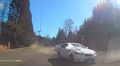 car barely avoids collision
