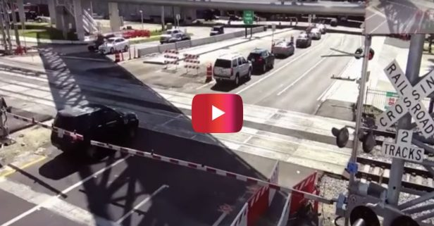 Train Smashes Into SUV in Intense Video