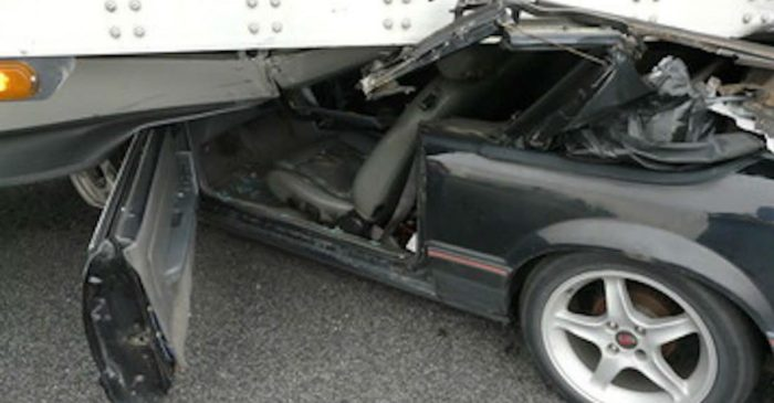 Semi Truck Drags Ford Mustang for Half-Mile Before Realizing It