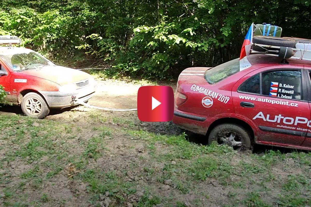 car tries towing rally car