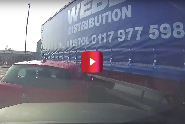 Trucker Seemingly Forgets He's Pulling a Trailer and Takes Out 2 Cars