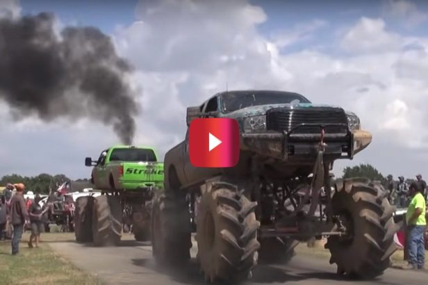 Coal-Spewing Monster Trucks Get the People Going at Tug of War Contest