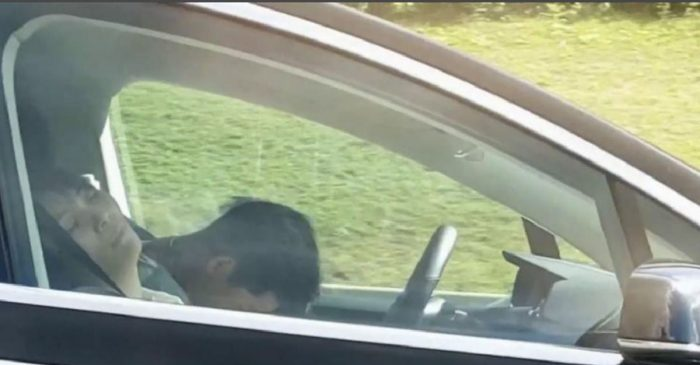 Real or Fake? Video Shows Tesla Driver Sleeping While Driving Down Highway