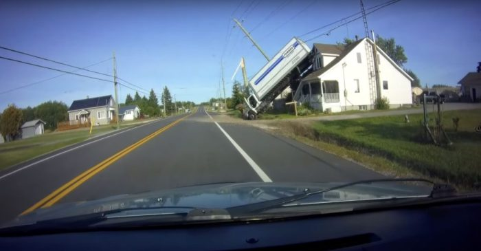 Shocking Video Shows Truck Crash Into Telephone Pole and Flip Onto a HOUSE