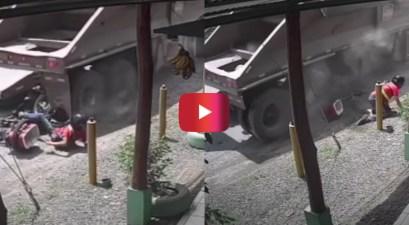trucks runs over motorcycle